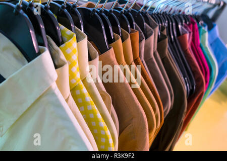 Male men's shirts on hangers on a shop rail - Stock Photo