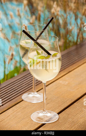 fresh hugo with mint lime and champagne in a weinglaß - Stock Photo