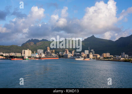Mauritius, capital city of Port Louis. Waterfront view of the port area and downtown. - Stock Photo
