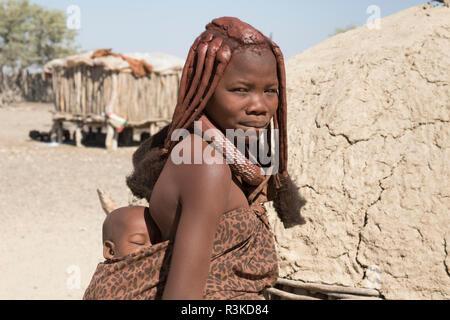 Africa, Namibia, Opuwo. Himba mother and baby. Credit as: Wendy Kaveney / Jaynes Gallery / DanitaDelimont.com - Stock Photo