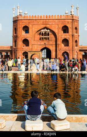 India, Old Delhi. No Water No Life expedition, Jami Masjid (India's largest mosque), entrance arch and courtyard with reflecting pool - Stock Photo