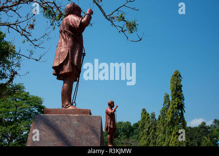 India, South Andaman Island, Port Blair. Infamous Cellular Jail National Monument. Veer Savarkar Park and memorial, statue of chained prisoner. - Stock Photo