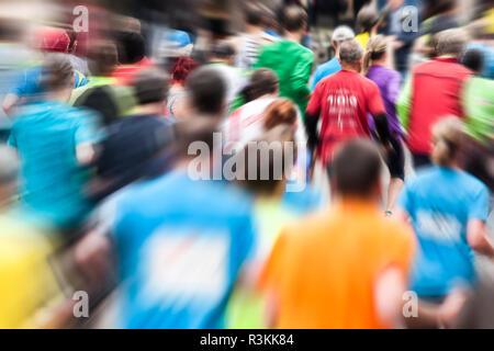 Running crowds at the marathon run - Stock Photo