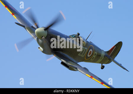 Second World War Supermarine Spitfire IX MH434 airplane. World War Two fighter plane flying at an airshow. Space for copy - Stock Photo