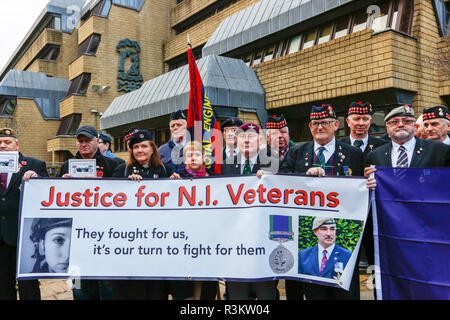 Glasgow, Scotland, UK. 23rd November, 2018. As part of a nationally coordinated action in cities across the UK including Manchester, London and Glasgow military veterans paraded outside the Ministry of Defence offices in Glasgow to draw attention to the perceived continuing persecution of those who served in the conflicts of Northern Ireland before the Peace Treaty signed by TONY BLAIR.   Credit: Findlay/Alamy Live News - Stock Photo