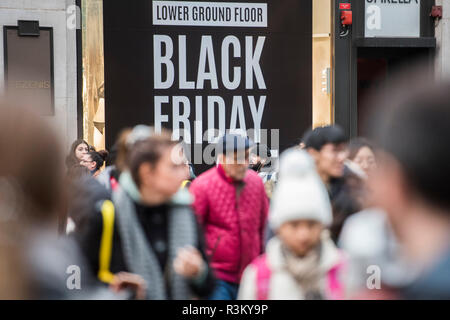 London, UK. 23rd Oct 2018. The road junction at Oxford Circus is blocked for a few minutes at a time as masses of Black friday shoppers get on with their shopping. Extinction Rebellion -  protest a potential 'Climate Change Catastrophe and Ecological Collapse'. A protest that involves blocking roads throughout London for brief periods of time. Credit: Guy Bell/Alamy Live News - Stock Photo