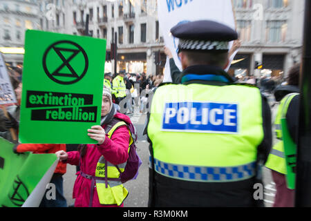 London UK 23 November 2018 Climate change activists from the Extinction Rebellion group block Oxford Street in Central London in protest that the government is not doing enough to avoid catastrophic climate change and to demand the government take radical action to save the planet. Credit: Thabo Jaiyesimi/Alamy Live News - Stock Photo