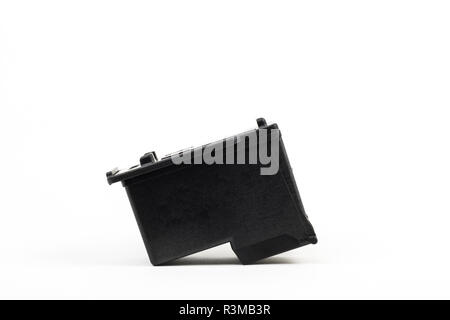 A black printer cartridge isolated in white with copy space. - Stock Photo