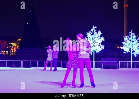 Orlando, Florida. November 18, 2018. Lovely Couple's skating on ice at Christmas Show in International Drive area. - Stock Photo