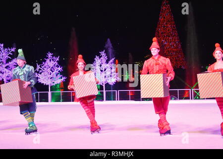 Orlando, Florida. November 19, 2018 Nice elves whith gift skating on ice at Chritsmas Show in International Drive area. - Stock Photo