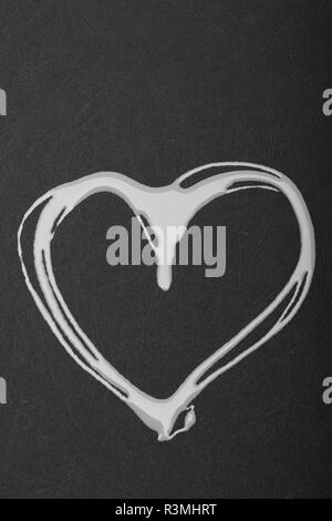 Heart painted with pink polish. Symbol of love on black surface. Valentines day and beauty concept. - Stock Photo