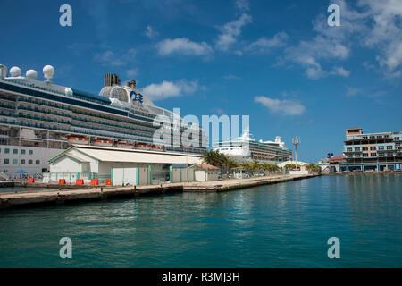 Caribbean, Aruba, Oranjestad. Royal Caribbean's Vision of the Seas and Princess's, Island Princess, ships in port. (Editorial Use Only) - Stock Photo