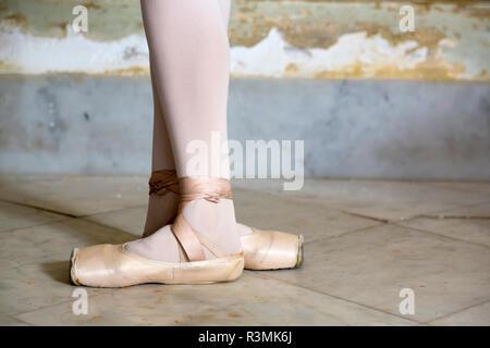 Cuba, Havana. Ballet position of ballerina's legs and feet. Credit as: Wendy Kaveney / Jaynes Gallery / DanitaDelimont.com - Stock Photo