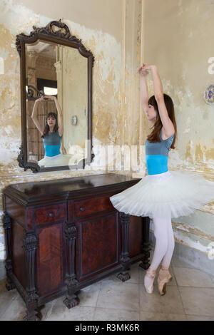 Cuba, Havana. Portrait of ballerina reflection in mirror. Credit as: Wendy Kaveney / Jaynes Gallery / DanitaDelimont.com - Stock Photo