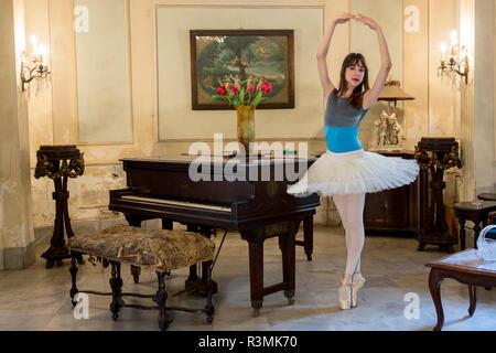 Cuba, Havana. Ballerina poses in parlor. Credit as: Wendy Kaveney / Jaynes Gallery / DanitaDelimont.com - Stock Photo