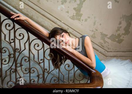 Cuba, Havana. Ballerina posing by antique staircase. Credit as: Wendy Kaveney / Jaynes Gallery / DanitaDelimont.com - Stock Photo