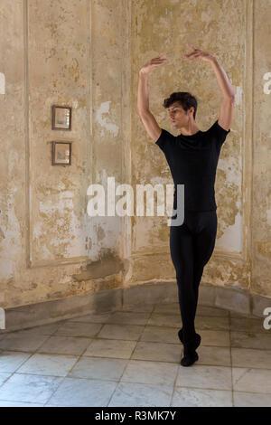 Cuba, Havana. Male dancer with ballet pose. Credit as: Wendy Kaveney / Jaynes Gallery / DanitaDelimont.com - Stock Photo