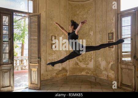 Cuba, Havana. Male dancer makes ballet leap. Credit as: Wendy Kaveney / Jaynes Gallery / DanitaDelimont.com - Stock Photo