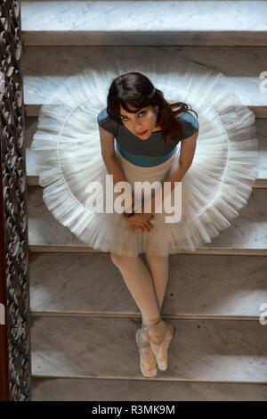 Cuba, Havana. Portrait of ballerina sitting on staircase. Credit as: Wendy Kaveney / Jaynes Gallery / DanitaDelimont.com - Stock Photo