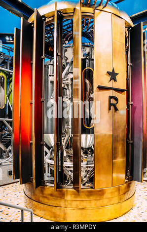 Milan, Italy - Nov 22, 2018: Industrial coffee grinder at the first Starbucks concept store in Milan, Italy known as the Milano Roastery - Stock Photo
