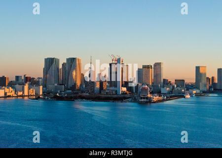 High-rises along the waterfront in Tokyo Harbor at dawn, Tokyo, Japan - Stock Photo