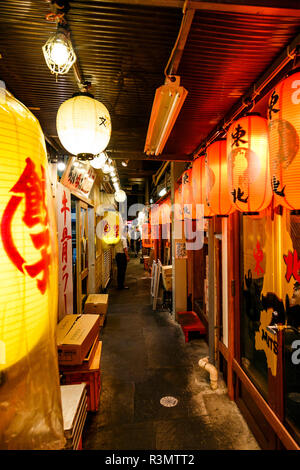 Tokyo, Japan. Traditional small street restaurants and food stalls called Yokocho, in Shinjuku - Stock Photo