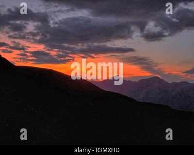 Rote Sonne am Himmel - Stock Photo