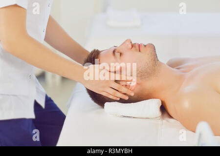 Facial massage for man.  - Stock Photo