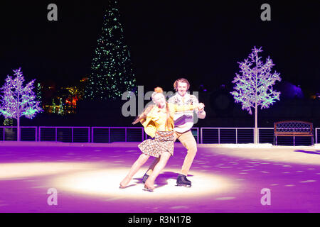 Orlando, Florida. November 17, 2018. Nice couple skating on ice at Christmas Show in International Drive area. - Stock Photo