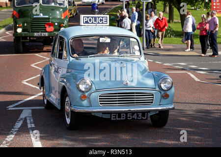 Morris Minor vintage police car taking part in a vintage historic car rally in northern ireland - Stock Photo