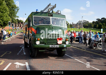 green old historic military bedford green goddess fire engine taking part in a vintage historic car rally in northern ireland - Stock Photo
