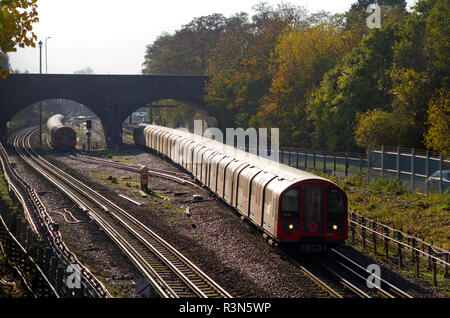 A Central Line train formed of London Underground 1992 stock heads north at Newbury Park. 9th November 2018. - Stock Photo