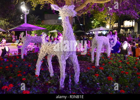 Orlando, Florida.  November 18, 2018. Reindeers made with branches painted white, on colorful flowerbed in Lake Buena Vista area. - Stock Photo