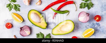 Ingredients for guacamole: avocado, lime, tomato, onion and spices, top view. - Stock Photo