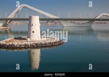 UAE, Abu Dhabi. Sheikh Zayed Bridge, designed by Zaha Hadid and old Al Maqta Fort watchtower - Stock Photo