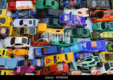 ATHENS, GREECE - OCTOBER 2, 2018: Old toy car collection for sale at street market. Vintage miniature automobile scale model replicas. - Stock Photo