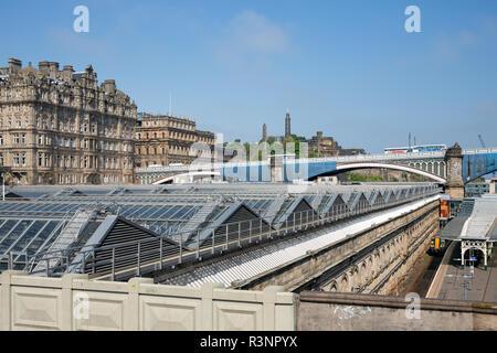 Glass rooftop of Edinburgh Waverley Railway station - Stock Photo