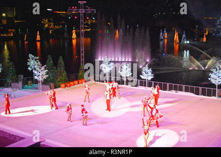 Orlando, Florida. November 19, 2018.  End of Christmas Show on ice on colorful background with holidays trees over the lake in International Drive are - Stock Photo