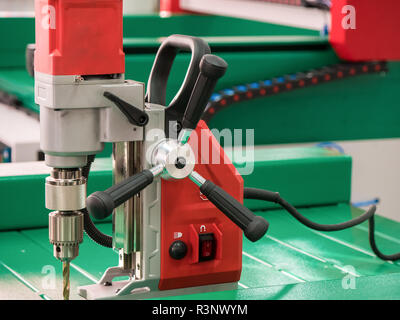 Automated CNC equipment for working with metal at factory. Electro drill machine. The programmed robot head. - Stock Photo