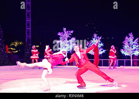 Orlando, Florida. November 20, 2018. Professional figure skaters performing  on Christmas on  Ice Show in SeaWorld. - Stock Photo