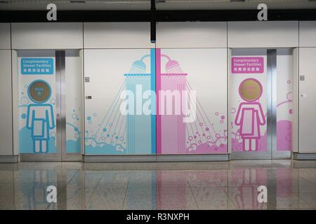 Entrance to men's and women's complimentary shower facilities at Hong Kong International Airport, China - Stock Photo