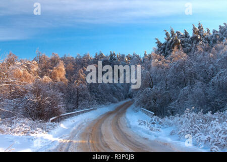 Wintry landscape scenery with modified cross country skiing way. Country house in winter weather, a lot of snow and sunny. Moscow region, Russia. - Stock Photo