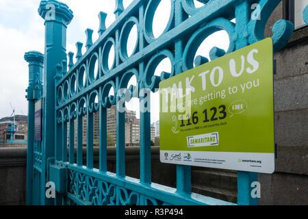 The Samaritans sign on blue gate in London, UK - Stock Photo