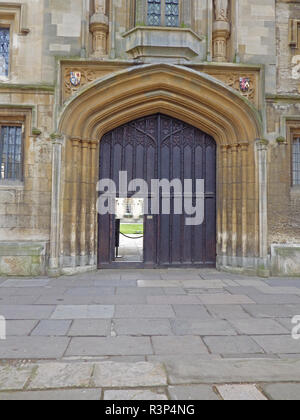 entrance to St John's college Oxford university from St Giles' showing the college crest and a glimpse of the main quadrangle - Stock Photo