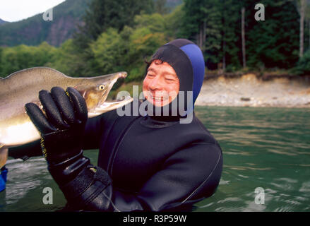 Scientist holding large Chinook Salmon, Vancouver Island, British Colombia (MR) - Stock Photo