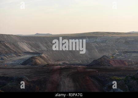 Empty open pit coal mine landscape in the Powder River Basin, Wyoming / USA. - Stock Photo