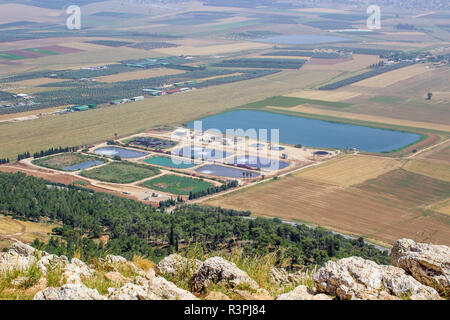 5 May 2018 A view of modern waste water treatment plant near Iskal in Israel from the Mount Precipice. The desert blooming like a rose - Stock Photo