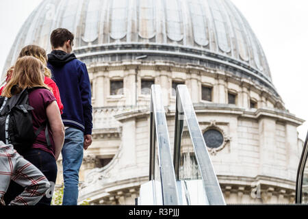 London England Great Britain United Kingdom City of London One New Change mall shopping centre center escalator view of St. Saint Paul's Cathedral dom - Stock Photo