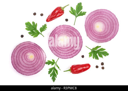 Sliced red onion rings with parsley leaves, hot pepper and peppercorns isolated on white background. Top view - Stock Photo