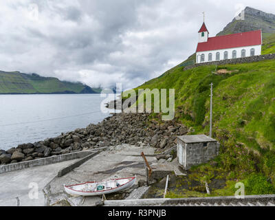 The island of Kunoy with village Kunoy and church. In the background island Kalsoy. Faroe Islands, Denmark - Stock Photo
